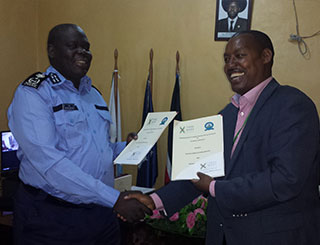 Lt.-Gen.-Mikaya-Modi-Legge,-Director-General-of-South-Sudan-Customs-Services-(SSCS)-shakes-hands-with-Eugene-Torero,-TradeMark-East-Africa-(TMEA)-South-Sudan-Director-during-the-MOU-signing