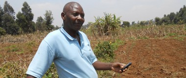 George uses his mobile phone to text iShamba