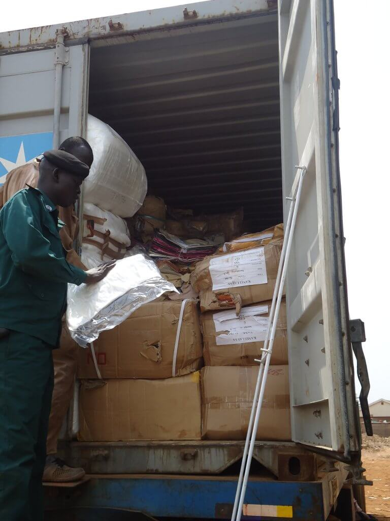 Manual goods inspection at the Nimule OSBP, SouthSudan